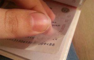 Отклеилась пленка от паспорта.